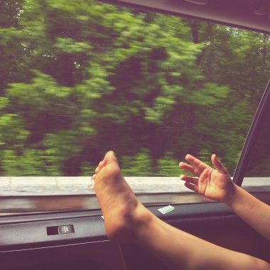 """out the window"" is pretty much where a foot should be when you're on a road trip."