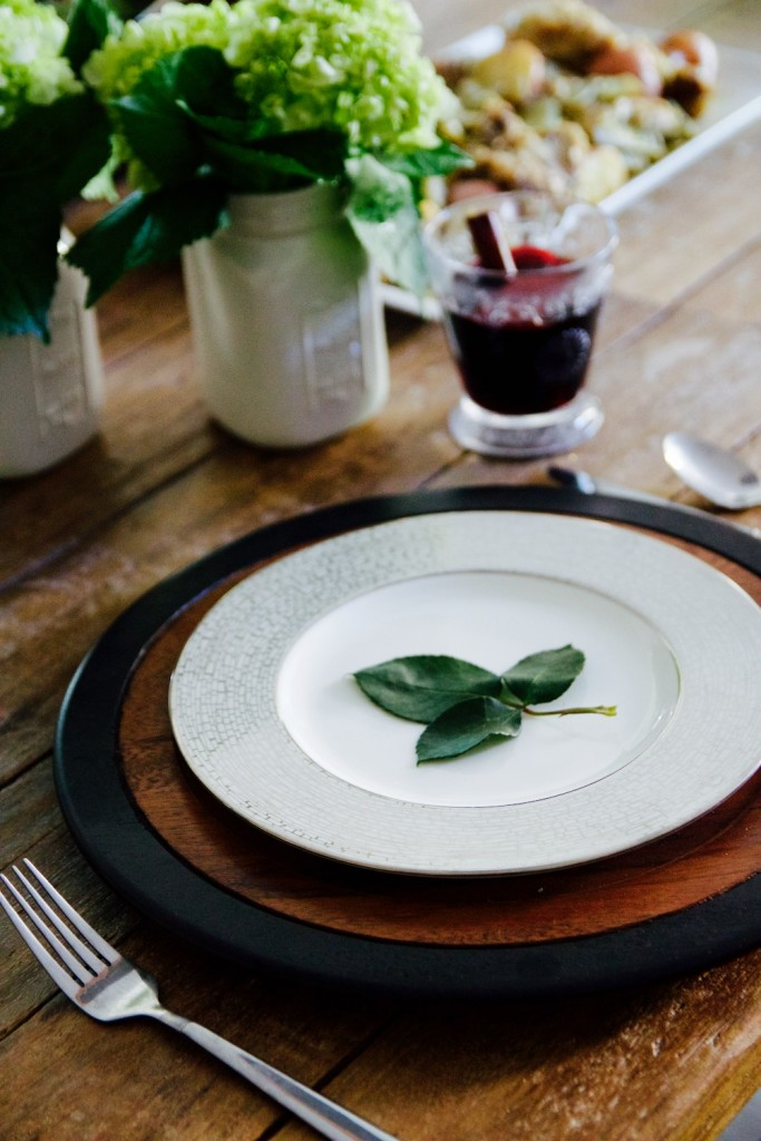 easy place setting of rose leaf trios set on a white and silver plate