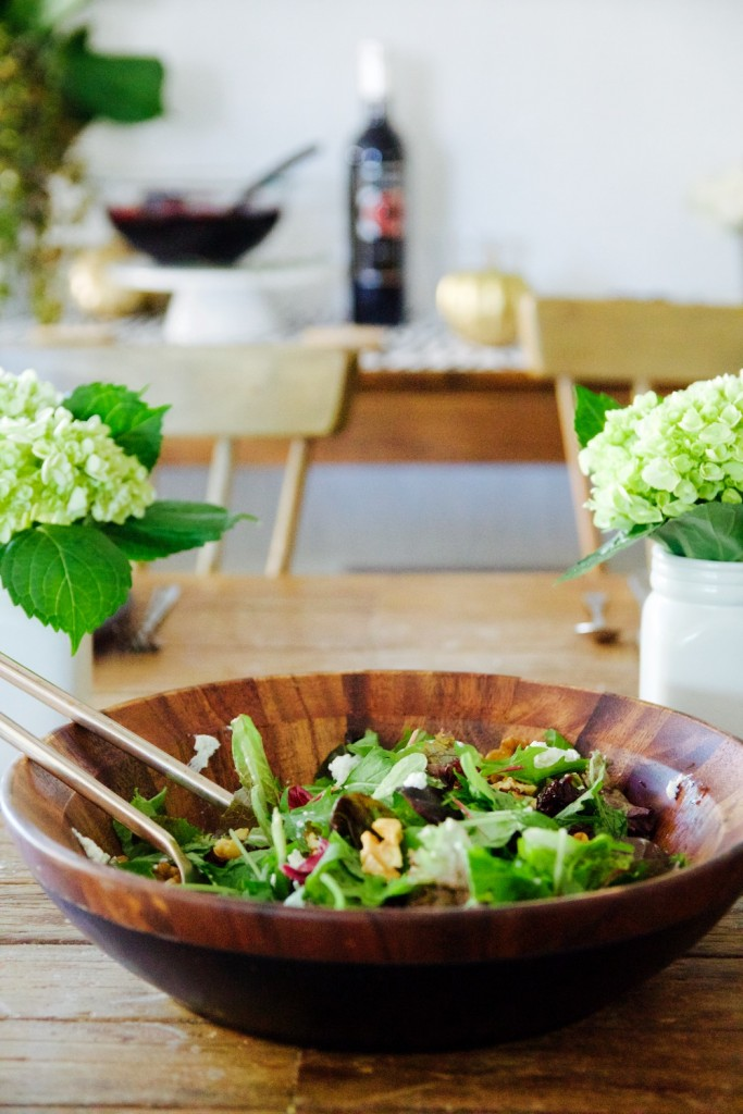 apple, walnut and cherry tossed salad in wooden serving bowl