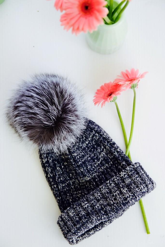 Adrienne Landau knit beanie with an oversize pom pom