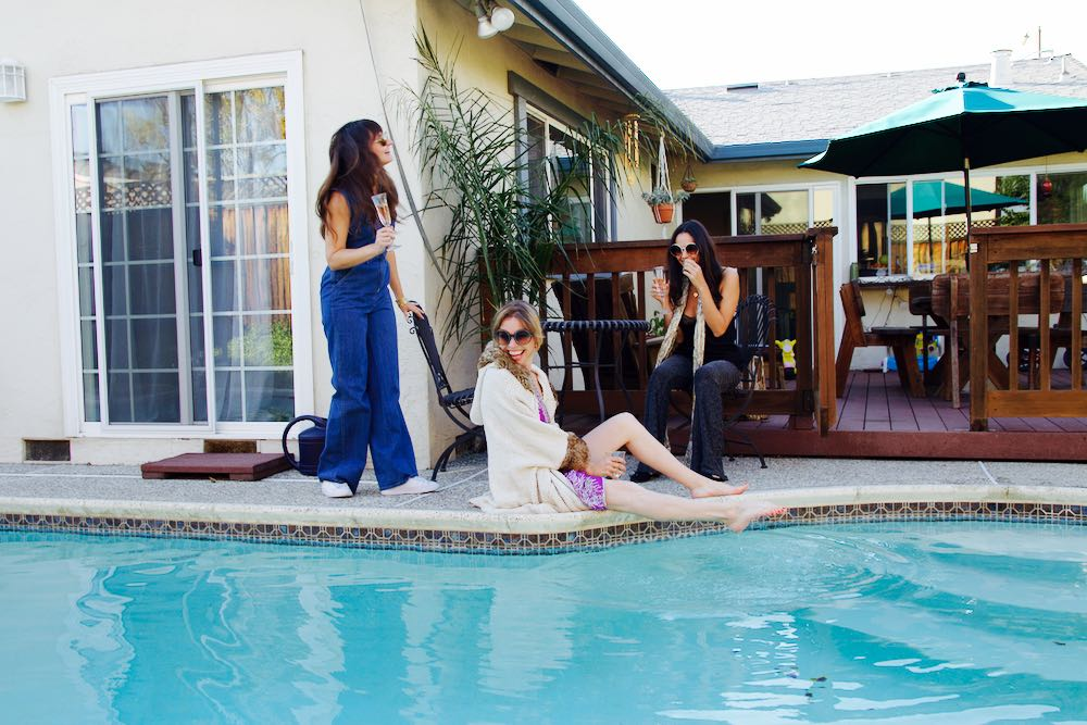 Girls by the pool in 1970s inspired outfits