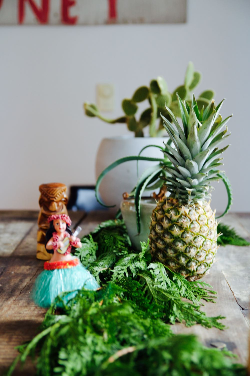 interesting retro holiday tablescape with pineapples and a hulu dancer