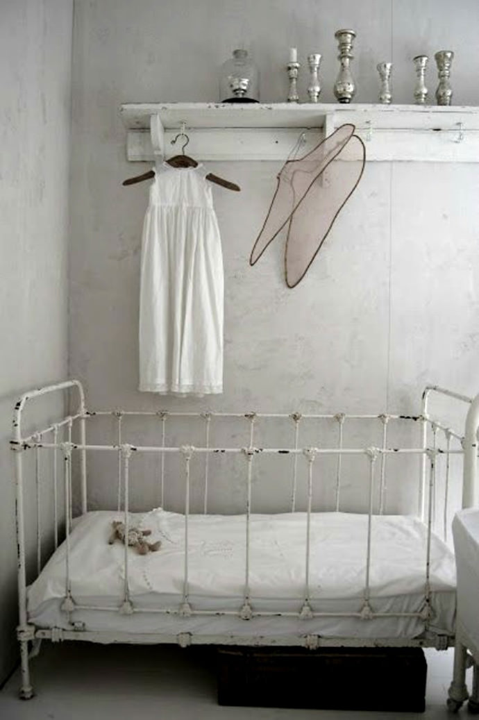 victorian inspired nursery with clean white colors