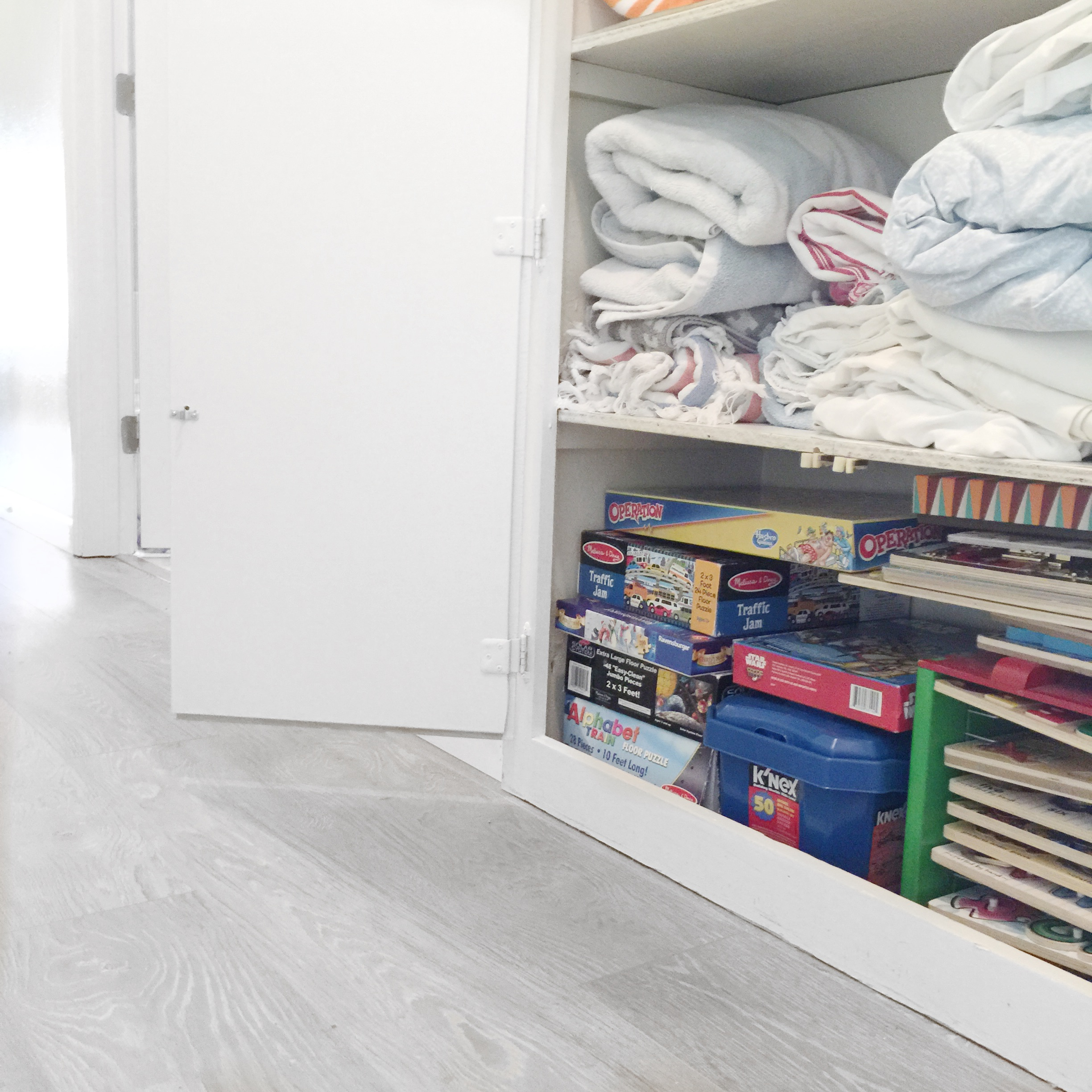 Organized linen closet and toy storage