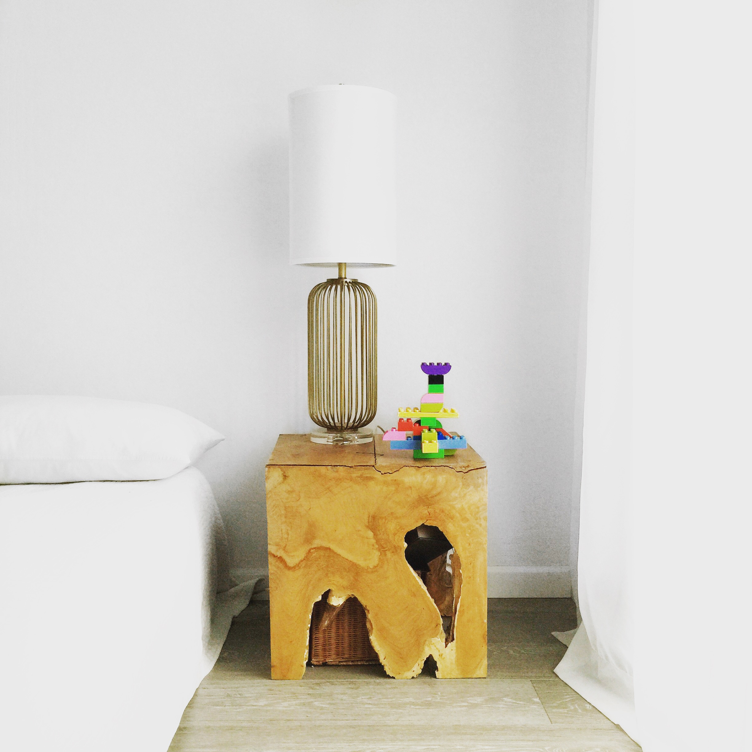 Reclaimed natural teak wood end tables with midcentury modern lamp