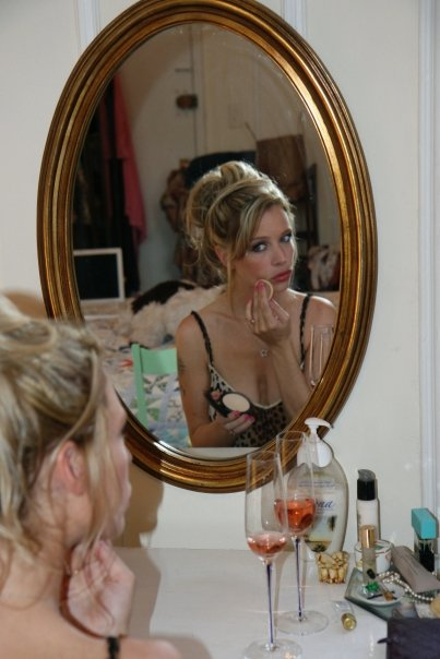 Putting on a makeup at a vintage vanity