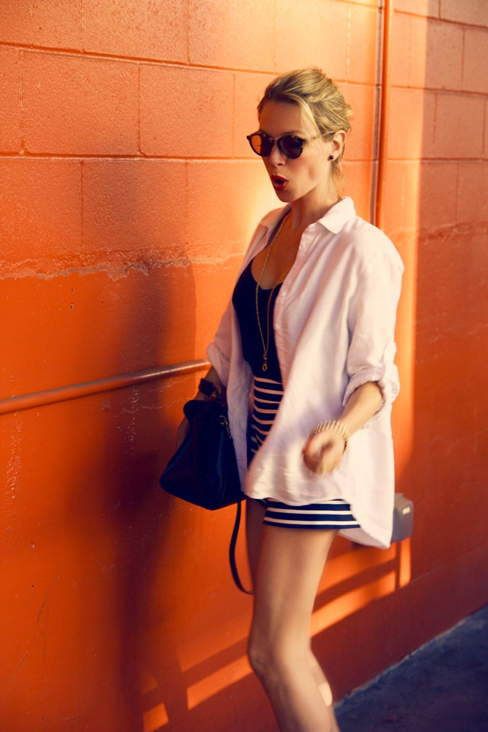 White shirt with blue and white striped shorts