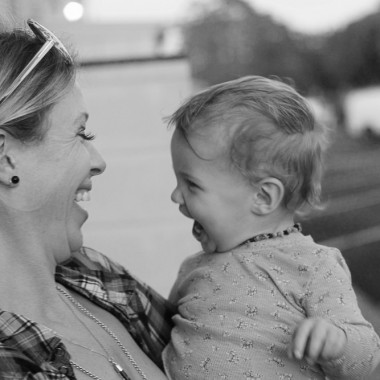 Mother and daughter laughing in black and white