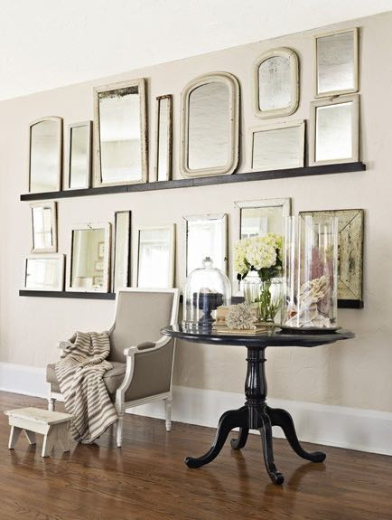 Gallery wall of vintage mirrors