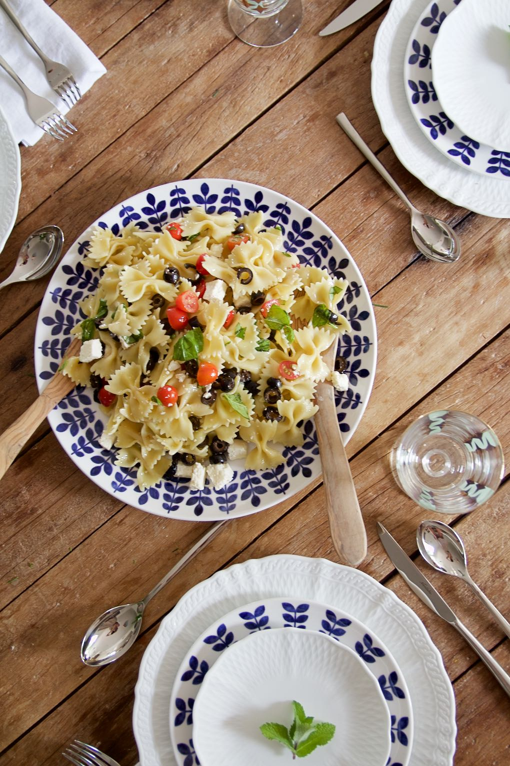 pasta with tomatoes, olives, cheese and basil