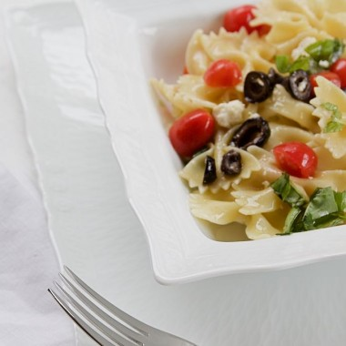 Farfalle pasta with cotija cheese and tomatoes