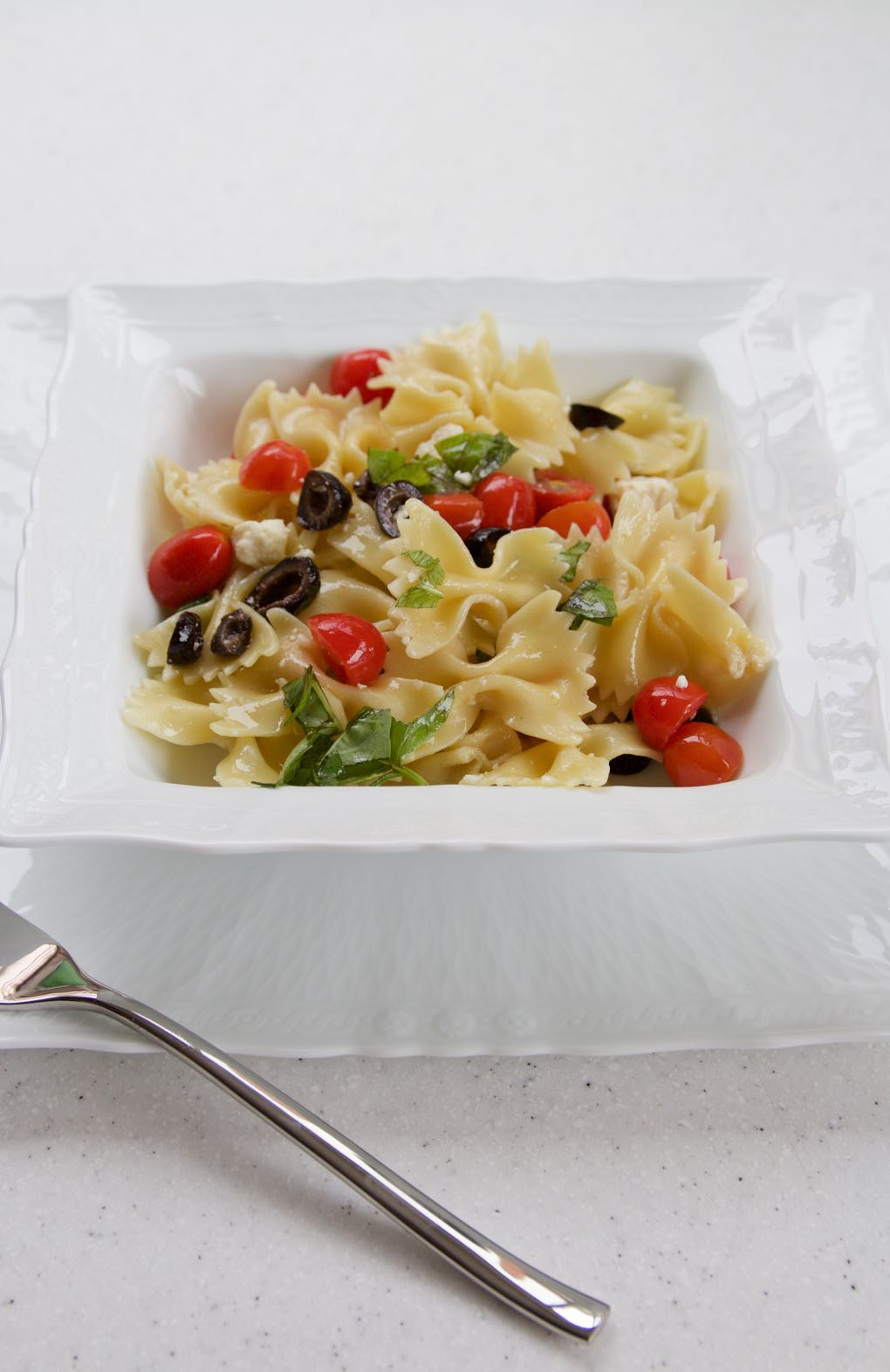 Pasta with cotija cheese and olives