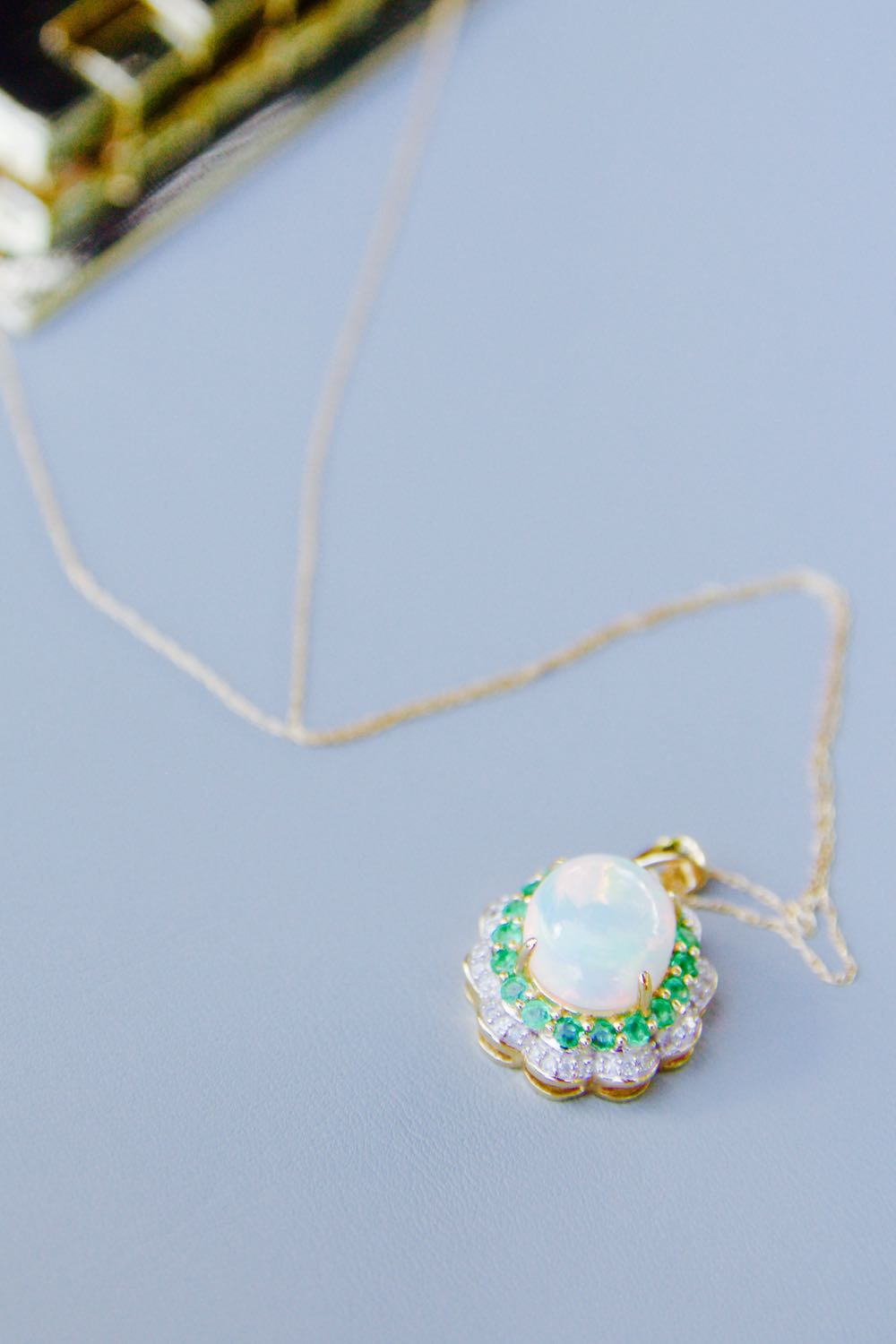 Opal necklace with diamonds and emeralds for a giveaway