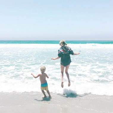 Jordan Reid and son at the beach in California