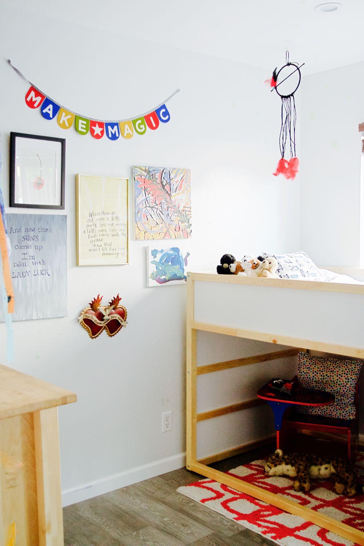 The Ikea Kura bunk bed in a little boy's room