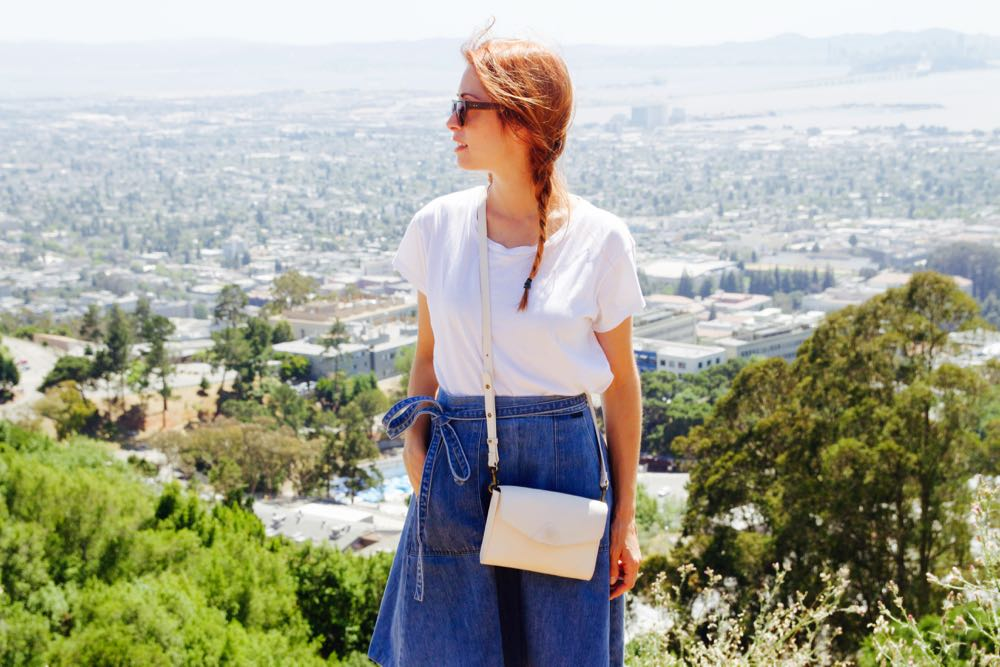 Brie Barbaccia in a white t-shirt and high-waisted denim skirt