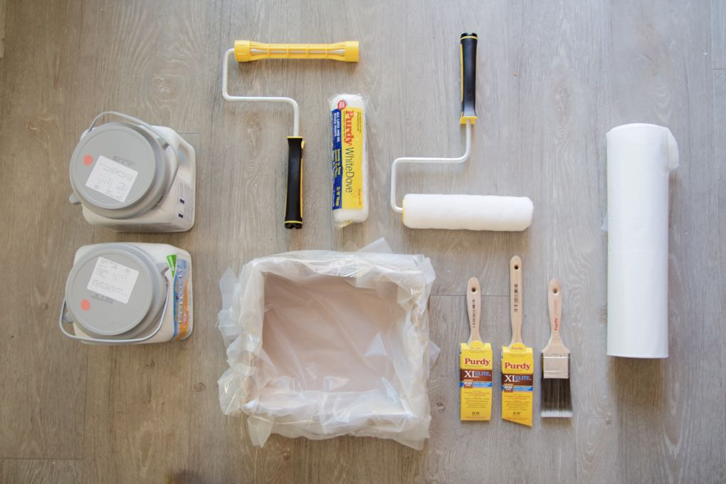 Supplies for painting a small bathroom