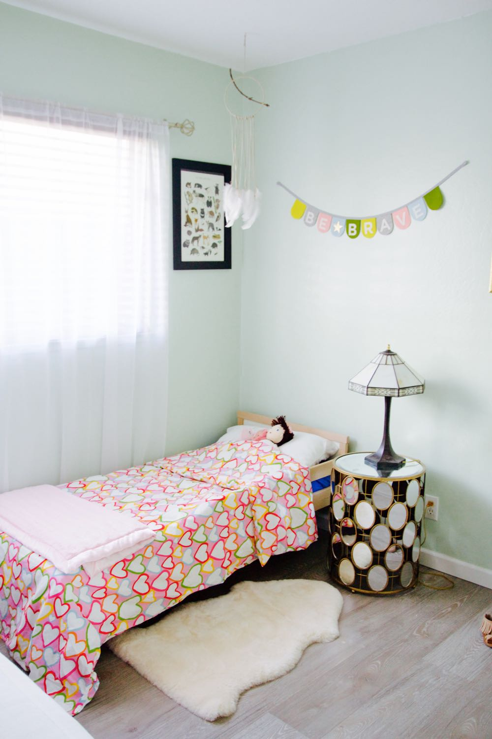 Not too girly little girl's room in pale green and pink