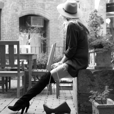 Blogger wearing stuart weitzman highland boots