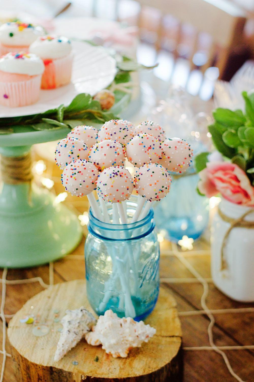 Pink cake pops in a blue mason jar
