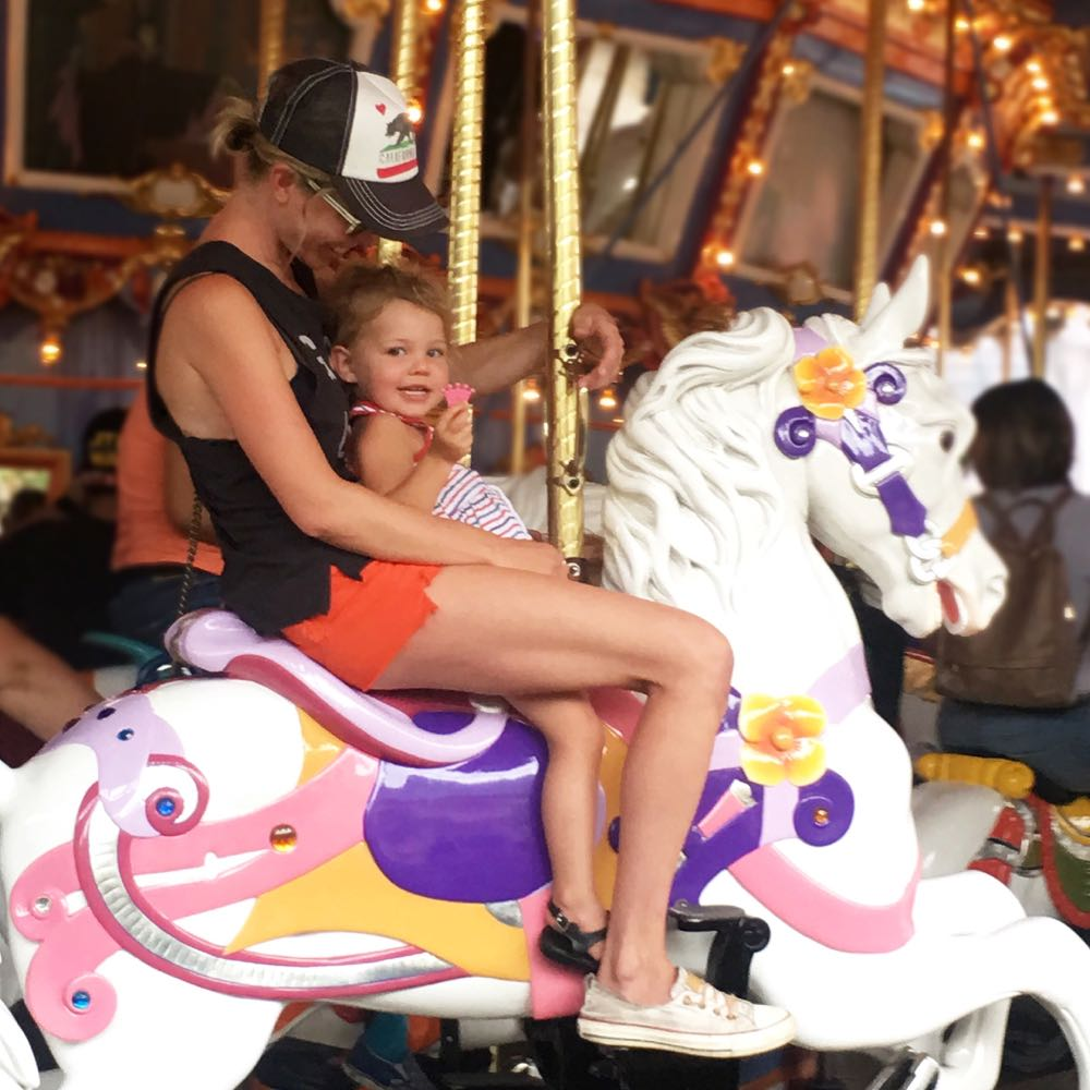 riding the carousel at disneyland