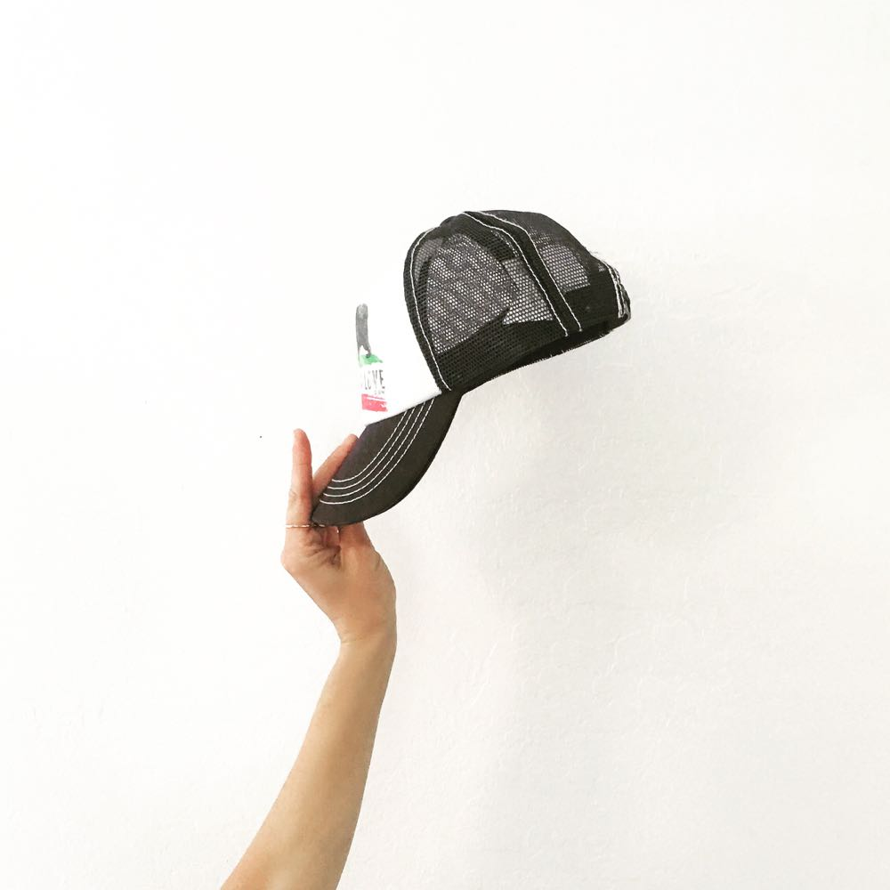 black trucker hat with california love on the front
