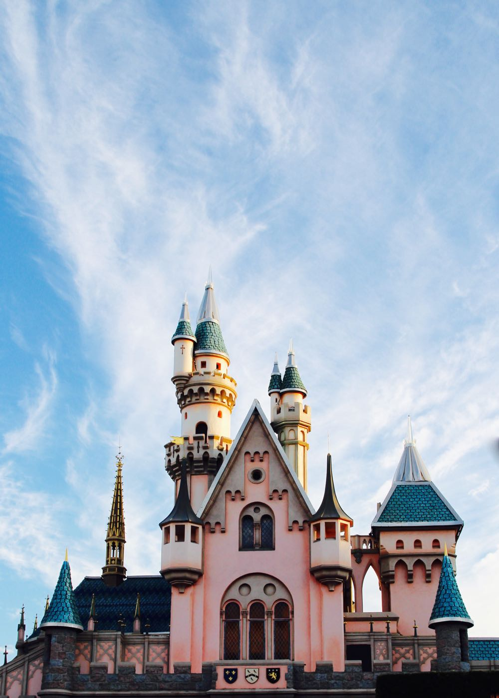 beautiful shot of the disney castle against the sky
