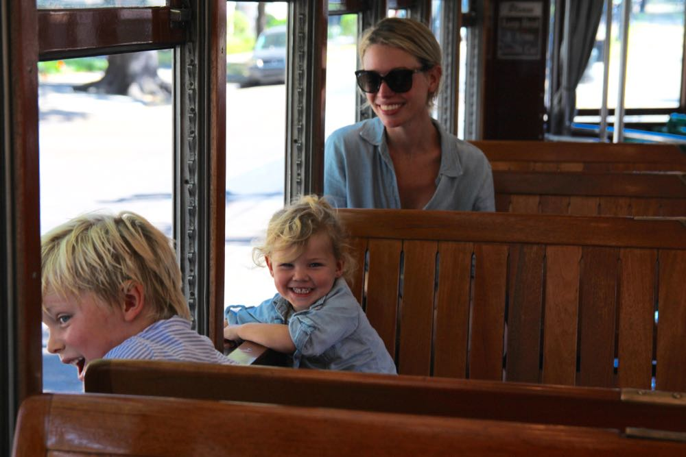 family streetcar ride in new orleans with ramshackle glam