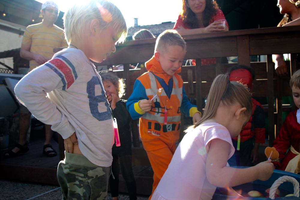 Activity ideas for a kids Halloween party including bobbing with apples