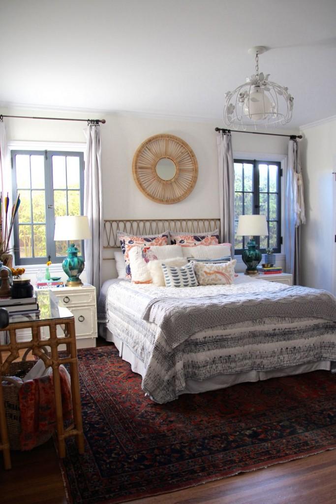Beautiful boho bedroom with mirror