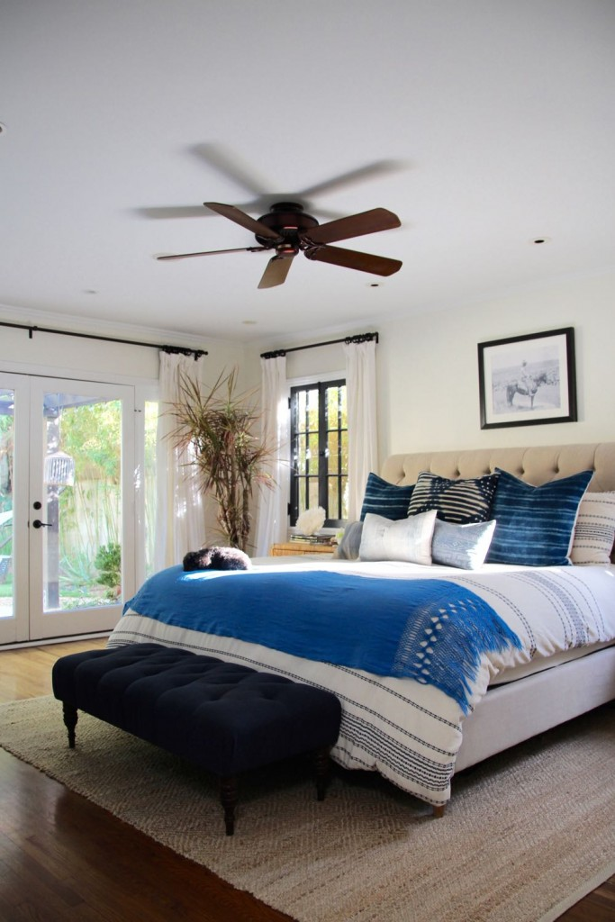 Clean and modern master bedroom with white and blue