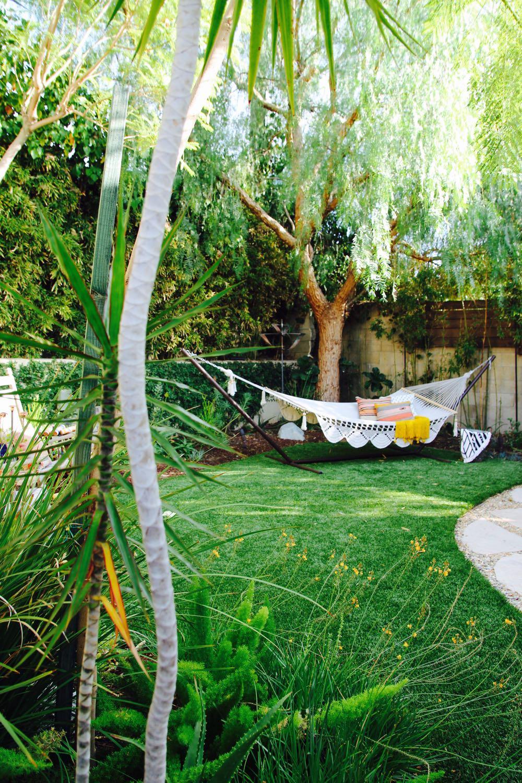 Beautiful boho backyard with tasseled hammock