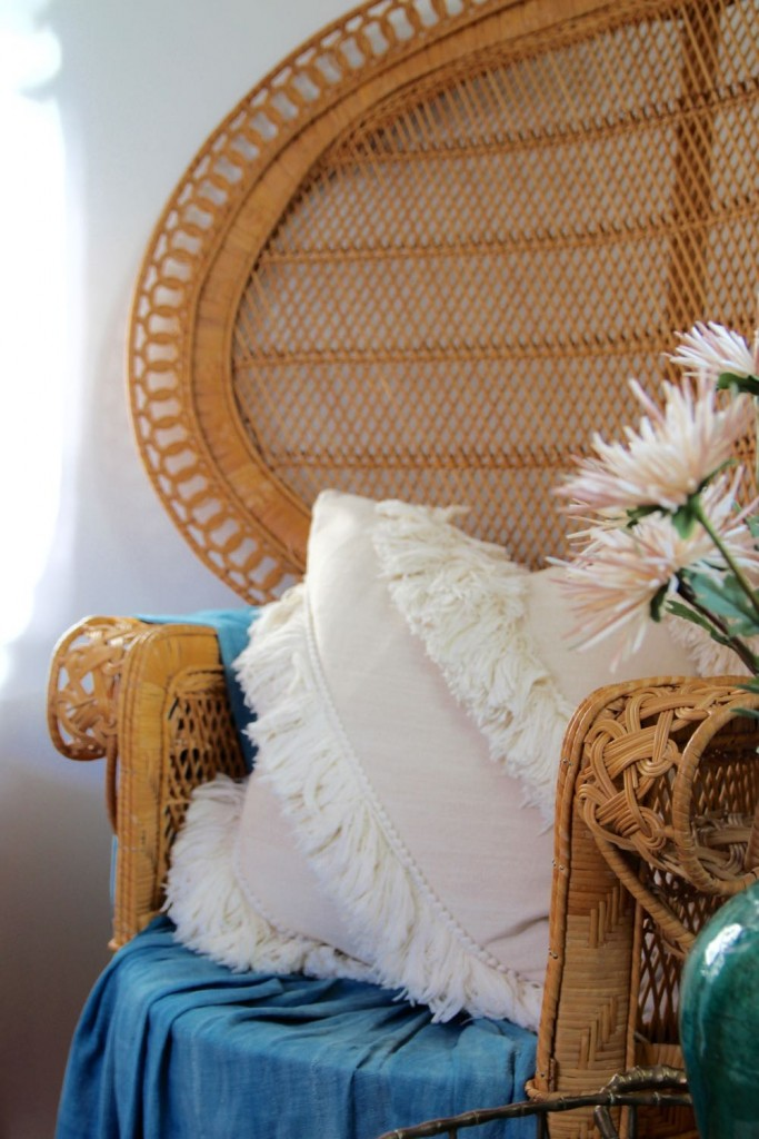 Oversize '70s era chairs with white tassel pillows