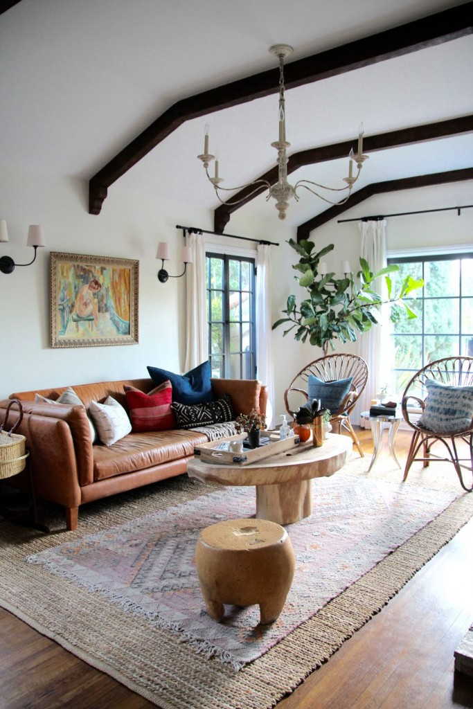 Beautiful living room with exposed arched beams and a leather couch