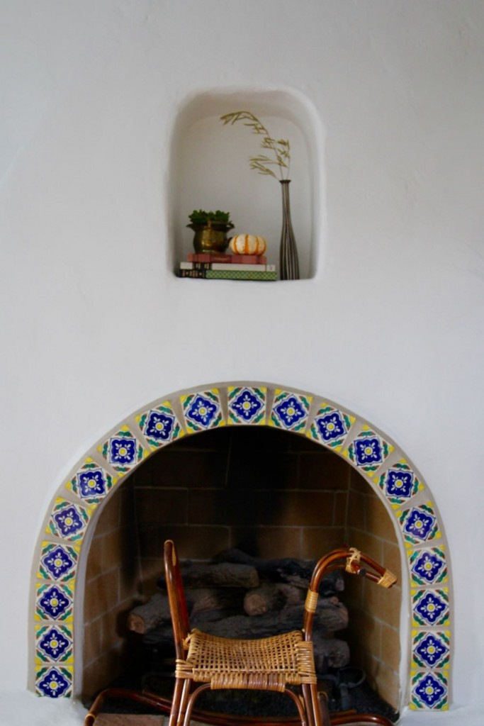 Tiled fireplace in a spanish style home in los angeles