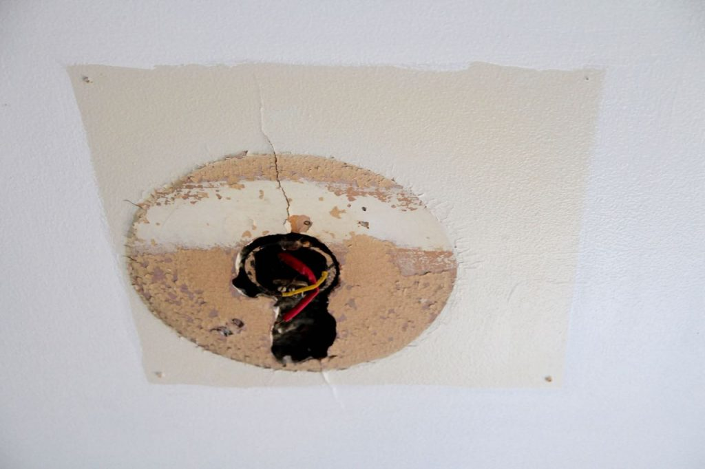 how to repair a medium sized hole in drywall step by step