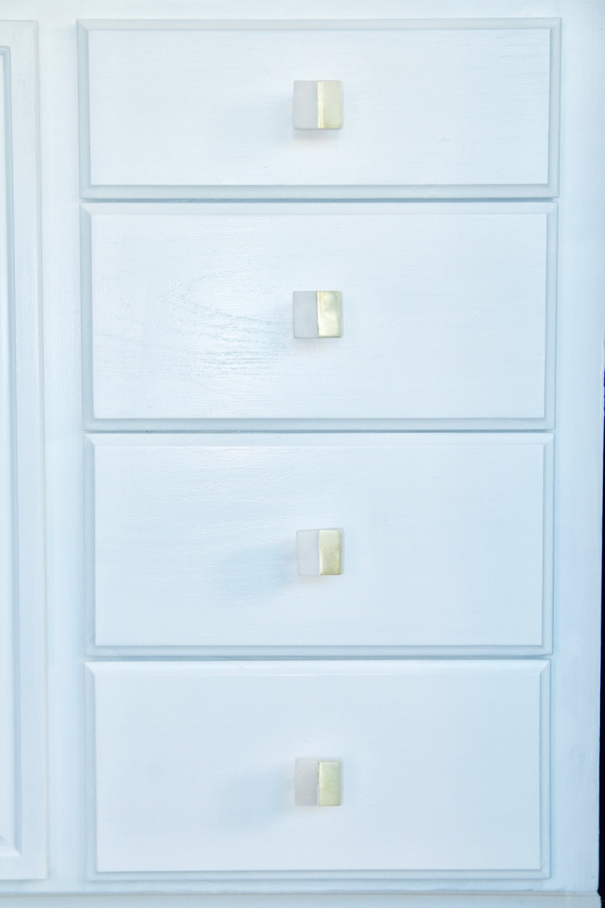 gold and white marble cabinet or drawer pulls