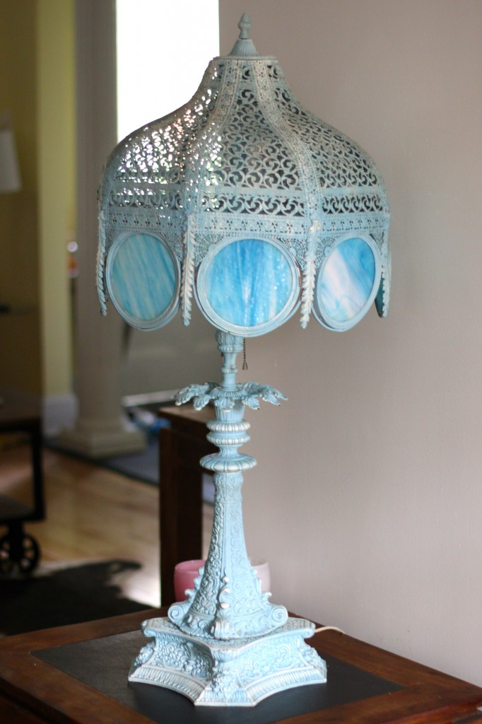 large wrought iron base lamp with translucent blue glass panels
