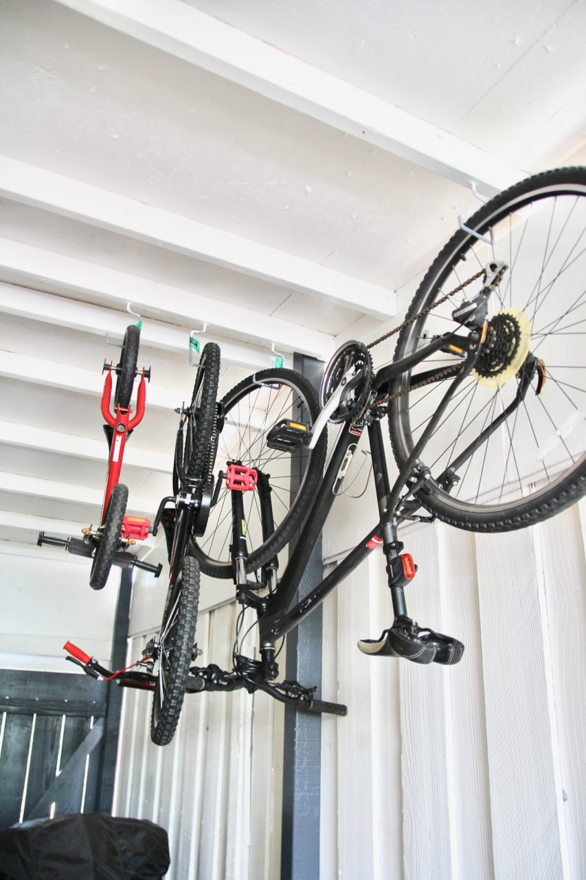 bike hooks hanging from ceiling
