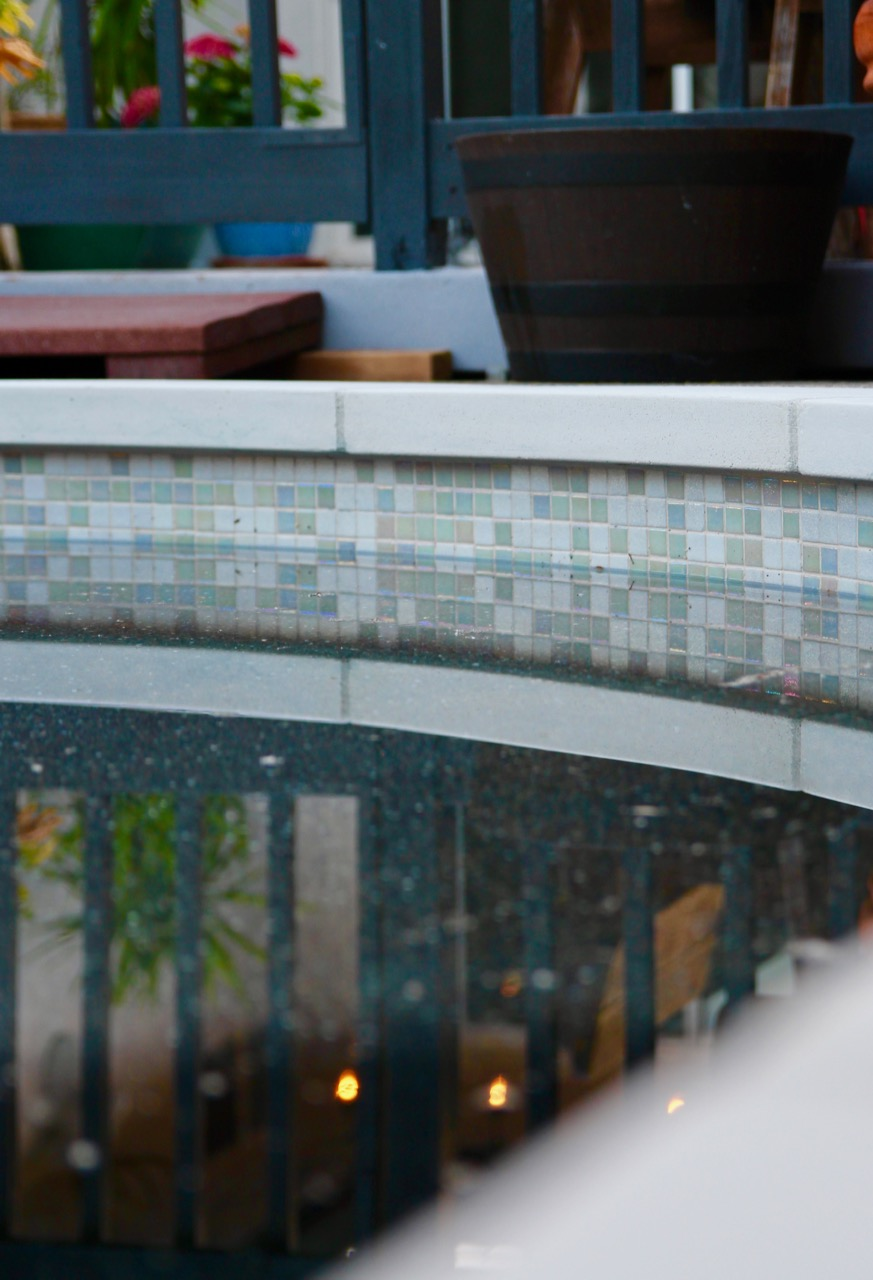 white iridescent pool tiles rainbow