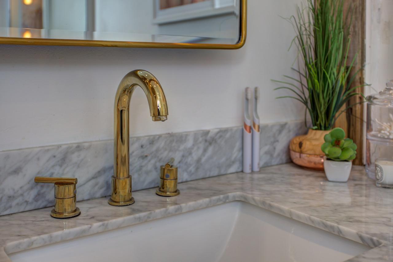 gold gooseneck bathroom faucet